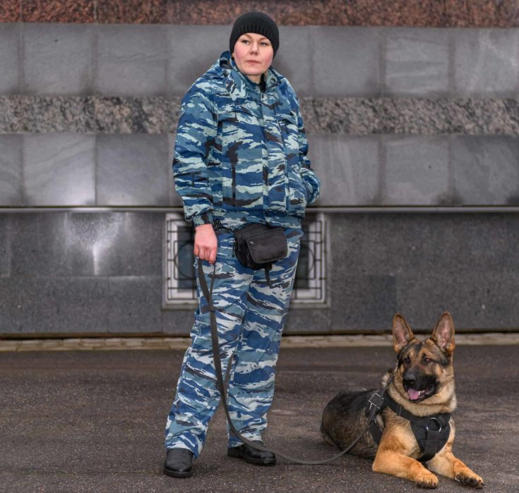 Female police officers with a trained dog.