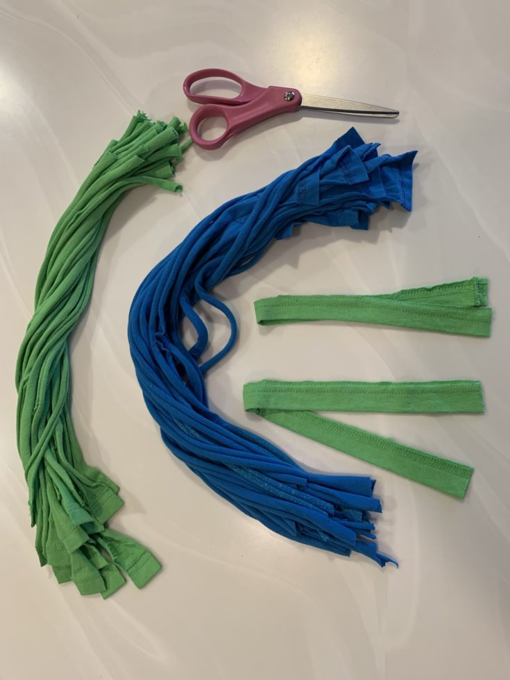 2 colors of cloth strips and scissors