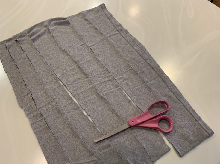 Gray cloth strips and scissors