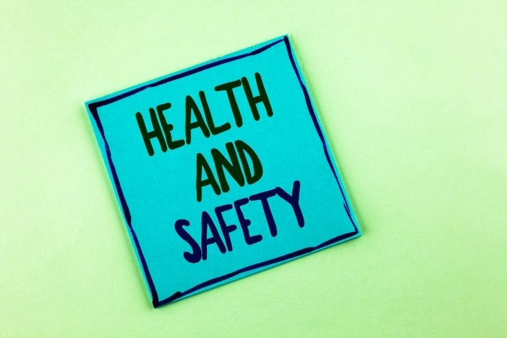 Health And Safety text on a post it note